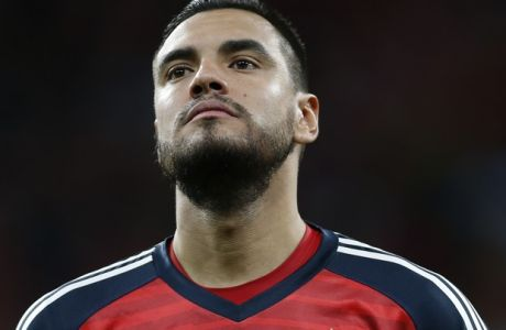 Argentina's goalkeeper Sergio Romero listens to national anthems during the international friendly soccer match between Spain and Argentina at the Wanda Metropolitano stadium in Madrid, Spain, Tuesday, March 27, 2018. (AP Photo/Francisco Seco)