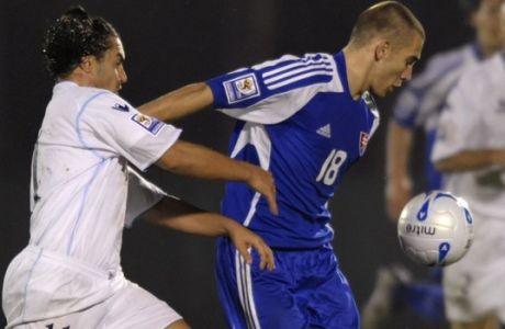 San Marino's  Michele Marani, left, and Slovakia's Erik Jendrisek fight for the ball during their World Cup group 3 qualifying  soccer match in San Marino, Saturday, Oct. 11, 2008. (AP Photo/Marco Vasini)