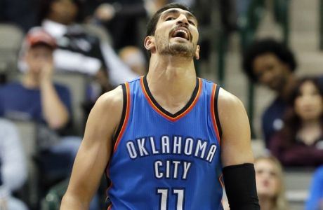 Oklahoma City Thunder center Enes Kanter of Turkey looks up, holding the ball after being charged with a foul during a preseason NBA basketball game against the Dallas Mavericks on Tuesday, Oct. 11, 2016, in Dallas. (AP Photo/Tony Gutierrez)