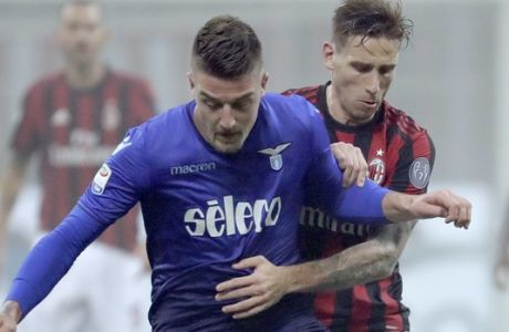 Lazio's Sergej Milinkovic-Savic, left, and AC Milan's Lucas Biglia vie for the ball during a Serie A soccer match between AC Milan and Lazio, at the San Siro stadium in Milan, Italy, Sunday, Jan. 28, 2018. (AP Photo/Luca Bruno)