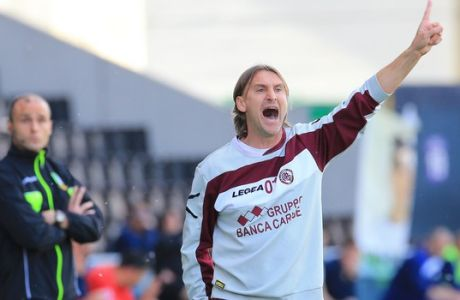 Livorno's coach Davide Nicola shouts during the Serie A soccer match between Udinese and Livorno at the Friuli Stadium in Udine, Italy, Sunday, May 4 2014. (AP Photo/Paolo Giovannini)