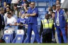 Chelsea head coach Maurizio Sarri watches the players warm up before the English Premier League soccer match between Chelsea and Arsenal at Stamford bridge stadium in London, Saturday, Aug. 18, 2018. (AP Photo/Tim Ireland)