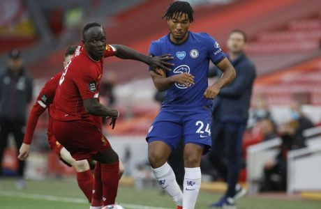 Liverpool's Sadio Mane, left vies for the ball with Chelsea's Reece James during the English Premier League soccer match between Liverpool and Chelsea at Anfield Stadium in Liverpool, England, Wednesday, July 22, 2020. (Phil Noble/Pool via AP)