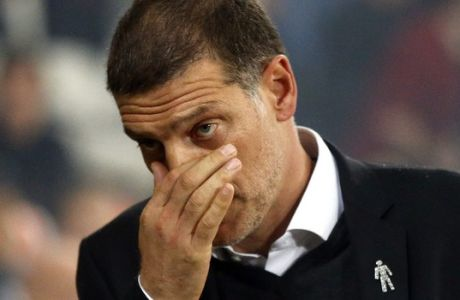 FILE - This is a Monday, Sept. 11, 2017  file photo of West Ham's manager Slaven Bilic as he reacts during the English Premier League soccer match between West Ham United and Huddersfield Town at London Stadium in London.  Bilic, on Monday Nov. 6, 2017, was fired by West Ham after 2 1/2 years as manager of the Premier League club. West Ham's owners made the decision following the team's 4-1 home loss to Liverpool on Saturday. (AP Photo/Frank Augstein/File)