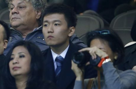 In this photo taken on Nov. 6, 2016, from left: Inter Milan CEO Liu Jun, Inter Milan Board of Directors members Ren Jun, Zhang Steven and Yang Yang attend a Serie A soccer match between Inter Milan and Crotone at the San Siro stadium in Milan, Italy. Next Sunday's will likely be Silvio Berlusconi's final derby as AC Milan owner. And the first for Inter's new Chinese proprietors.(AP Photo/Antonio Calanni)