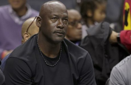 Charlotte Hornets owner Michael Jordan watches the action in the first half of an NBA basketball game against the Washington Wizards in Charlotte, N.C., Monday, Jan. 23, 2017. (AP Photo/Chuck Burton)