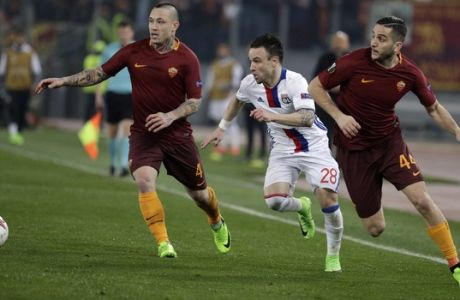 Lyon's Mathieu Valbuena, center, tries to run past Roma's Radja Nainggolan, left, and Roma's Kostas Manolas, right, during the Europa League round of 16 second leg soccer match between Roma and Lyon, in Rome's Olympic stadium, Thursday, March 16, 2017. (AP Photo/Andrew Medichini)