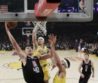Los Angeles Clippers' Ivica Zubac (40) drives to the basket as Los Angeles Lakers' Kyle Kuzma, center, and JaVale McGee, right, defend during the first half of an NBA basketball game, Monday, March 4, 2019, in Los Angeles. (AP Photo/Marcio Jose Sanchez)