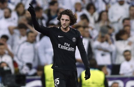 PSG's Adrien Rabiot celebrates after scoring the opening goal during a Champions League Round of 16 first leg soccer match between Real Madrid and Paris Saint Germain at the Santiago Bernabeu stadium in Madrid, Spain, Wednesday, Feb. 14, 2018. (AP Photo/Francisco Seco)
