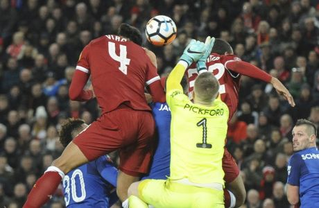 Liverpool's Virgil van Dijk, top left, heads the ball to score his side's second goal during the English FA Cup Third Round soccer match between Liverpool and Everton at Anfield in Liverpool, England, Friday, Jan. 5, 2018. (AP Photo/Rui Vieira)