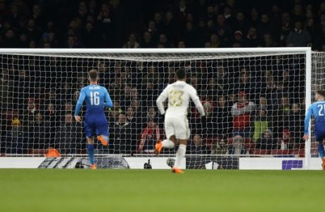 Players watch as Arsenal's Calum Chambers, right, scores an own goal during the Europa League Round of 32, second leg soccer match between Arsenal and Ostersunds FK at the Emirates Stadium in London, Thursday, Feb. 22, 2018. (AP Photo/Alastair Grant)