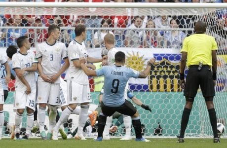 Uruguay's Luis Suarez, celebrates after scoring his side's first goal during the group A match between Uruguay and Russia at the 2018 soccer World Cup at the Samara Arena in Samara, Russia, Monday, June 25, 2018. (AP Photo/Gregorio Borgia)