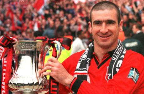 Manchester United's captain Eric Cantona holds the FA Cup following his team's win against Liverpool at London's Wembley Stadium Saturday May 11, 1996. Cantona scored the only goal in the last minutes of the game.(AP PHOTO/ Max Nash)