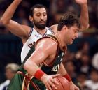 Lithuanias's Arvydas Sabonis (11) is guarded by Yugoslavia's Vlade Divac (12) in the first half of semifinals basketball competition at the Centennial Summer Olympic Games in Atlanta Thursday night, Aug. 1, 1996.   (AP Photo/Susan Ragan)