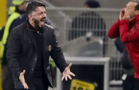 AC Milan coach Gennaro Gattuso reacts after forward Patrick Cutrone scored for his team during an Italian Cup quarter-final soccer match between Milan and Inter Milan at the San Siro stadium in Milan, Italy, Wednesday, Dec. 27, 2017. Milan beat Inter 1-0 and qualified. (AP Photo/Antonio Calanni)