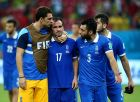 RECIFE, BRAZIL - JUNE 29: Theofanis Gekas (2nd L) is consoled by his teammates Stefanos Kapino (1st L), Giorgos Tzavellas (2nd R) after the defeat in the 2014 FIFA World Cup Brazil Round of 16 match between Costa Rica and Greece at Arena Pernambuco on June 29, 2014 in Recife, Brazil.  (Photo by Alex Grimm - FIFA/FIFA via Getty Images)