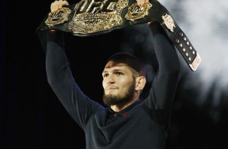 Khabib Nurmagomedov holds up a belt during a news conference for the UFC 229 mixed martial arts bouts Thursday, Oct. 4, 2018, in Las Vegas. Nurmagomedov is scheduled to fight Conor McGregor on Saturday in Las Vegas. (AP Photo/John Locher)