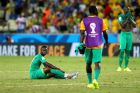 FORTALEZA, BRAZIL - JUNE 24: A dejected Ismael Diomande of the Ivory Coast sits on the field after being defeated by Greece 2-1 during the 2014 FIFA World Cup Brazil Group C match between Greece and Cote D'Ivoire at Estadio Castelao on June 24, 2014 in Fortaleza, Brazil.  (Photo by Alex Livesey - FIFA/FIFA via Getty Images)