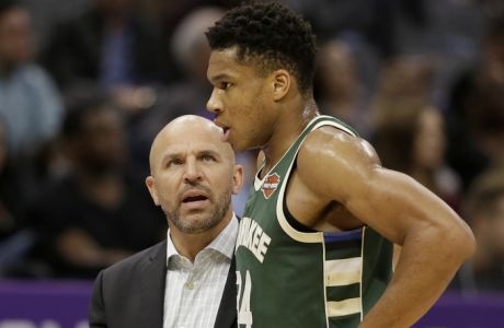Milwaukee Bucks head coach Jason Kidd talks with Bucks forward Giannis Antetokounmpo as he walks off the court during the first quarter of an NBA basketball game against the Sacramento Kings Tuesday, Nov. 28, 2017, in Sacramento, Calif. (AP Photo/Rich Pedroncelli)