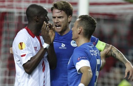 Liberec's Radoslav Kovac, argues with Sevilla's Stéphane Mbia, left, next to Liberec's Vladimír Coufal, right, during their Europa League group H soccer match at the Ramon Sanchez Pizjuan stadium in Sevilla, Spain, Thursday, Nov. 7, 2013.  (AP Photo/Toni Rodriguez)