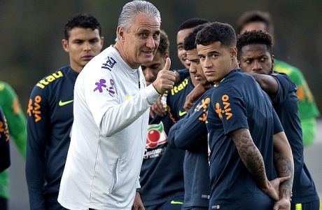Brazil Coach Tite flashes a thumbs up during a national soccer team practice session ahead the World Cup in Russia, at the Granja Comary training center In Teresopolis, Brazil, Friday, May 25, 2018. (AP Photo/Leo Correa)