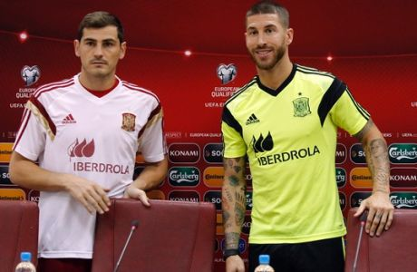 Spain's national soccer team players Iker Casillas, left, and Sergio Ramos arrive for a news conference one day ahead of their Group C, Euro 2016 qualifying soccer match against Macedonia, at the Philip II stadium, in Skopje, Macedonia, Monday, Sept. 7, 2015. (AP Photo/Vlatko Perkovski)