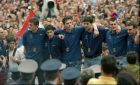 Yugoslav basketball players from left: Zeljko Rebraca, Miroslav Radosevic, dejan Tomasevic, Dejan Bodiroga, Zoran Savic and Miroslav Beric, stand in front of tens of thousands of Serbian basketball fans which greeted the Yugoslav national team upon their arrival in Belgrade, Monday July 7,1997.  Yugoslavia won the European title by beating Italy in the finals in Barcelona on Sunday.(AP Photo/ALEKSANDAR STANKOVIC)