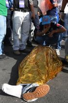 EDITORS NOTE: Graphic content / A man cries over the body of one of two supporters of Honduran team Motagua who were killed in a stampede at the National Stadium in Tegucigalpa on May 28, 2017. At least two people were killed and 25 injured in the chaos and unrest caused when hundreds of fans tried to enter the overcrowded stadium before the final match of the Clausura football tournament between Motagua and Honduras Progreso. / AFP PHOTO / ORLANDO SIERRA        (Photo credit should read ORLANDO SIERRA/AFP/Getty Images)