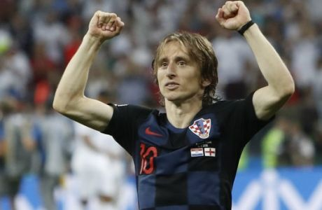 Croatia's Luka Modric celebrates after his team advanced to the final during the semifinal match between Croatia and England at the 2018 soccer World Cup in the Luzhniki Stadium in Moscow, Russia, Wednesday, July 11, 2018. (AP Photo/Alastair Grant)