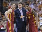 FILE - In this Feb. 21, 2015, file photo, Iowa State coach Fred Hoiberg, center, talks with Matt Thomas, left, and Monté Morris during an NCAA college basketball game against Texas, in Austin, Texas. Many college teams, including Iowa State, Indiana and Notre Dame, are increasingly passing up mid-range jumpers, looking for space and uncontested shots _ which these days are found are closer to the rim or beyond the 3-point line. I didnt know there was a problem with it until I got here, Morris said of the mid-range jumper. Coach (Hoiberg) doesnt really like them. Hed rather like lay-ups or 3-pointers. (AP Photo/Eric Gay, File)