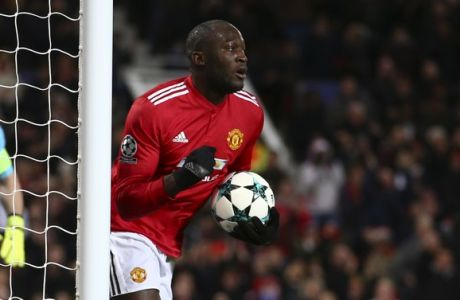 Manchester United's Romelu Lukaku celebrates after scoring his team first goal as CSKA's goalkeeper Igor Akinfeev, left, stands near the gates during the Champions League group A soccer match between Manchester United and CSKA Moscow in Manchester, England, Tuesday, Dec. 5, 2017. (AP Photo/Dave Thompson)