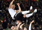Germany's Lukas Podolski is thrown up in the air by his teammates after the friendly soccer match between Germany and England in Dortmund, Germany, Wednesday, March 22, 2017. (AP Photo/Martin Meissner)