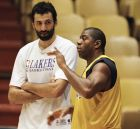 Earvin Magic Johnson, right, talks with Los Angeles Lakers teammate Vlade Divac during a workout on Thursday, Feb. 1, 1996 on the teams home court at the Forum in Inglewood, Calif. Magic Johnson pumped new life into basketball when he returned to the court this week after a 4½-year absence. On Friday night, Johnson will go up against Michael Jordan and the Chicago Bulls. (AP Photo/Reed Saxon)