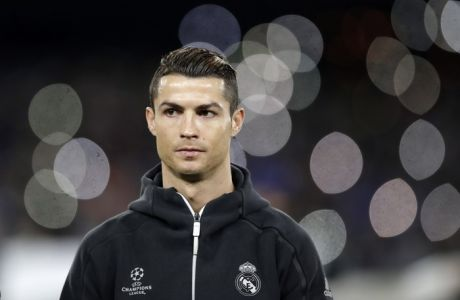 Real Madrid's Cristiano Ronaldo stands on the pitch before the Champions League round of 16, second leg, soccer match between Napoli and Real Madrid at the San Paolo stadium in Naples, Italy, Tuesday March 7, 2017. (AP Photo/Andrew Medichini)