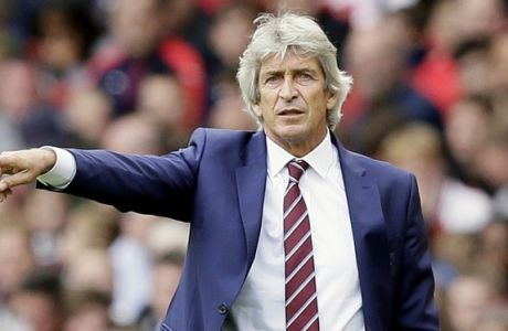 West Ham manager Manuel Pellegrini gives instructions during the English Premier League soccer match between Arsenal and West Ham United at the Emirates Stadium in London, Saturday Aug. 25, 2018. (AP Photo/Tim Ireland)