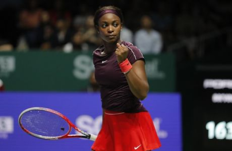 Sloane Stephens of the United States celebrates during her women's singles match against Naomi Osaka of Japan at the WTA tennis tournament in Singapore on Monday, Oct. 22, 2018. (AP Photo/Vincent Thian)