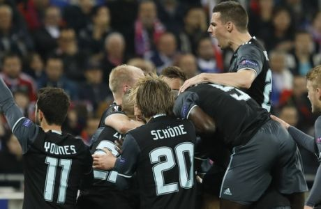 ajax players celebrate scoring their side's first goal during the second leg semi final soccer match between Olympique Lyon and Ajax in the Stade de Lyon, Decines, France, Thursday, May 11, 2017. (AP Photo/Laurent Cipriani)