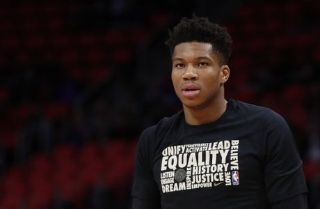 Milwaukee Bucks forward Giannis Antetokounmpo warms up against the Detroit Pistons in the first half of an NBA basketball game in Detroit, Wednesday, Feb. 28, 2018. (AP Photo/Paul Sancya)
