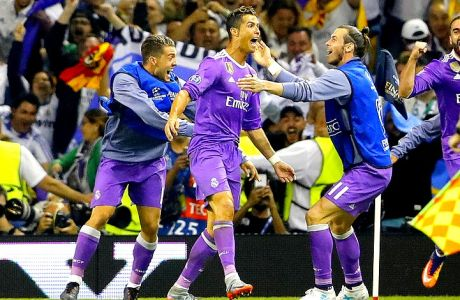 Real Madrid's Cristiano Ronaldo celebrates scoring his side's third goal with Gareth Bale, right, during the Champions League final soccer match between Juventus and Real Madrid at the Millennium stadium in Cardiff, Wales Saturday June 3, 2017. (AP Photo/Frank Augstein)