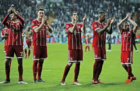 Bayern's players wave to their fans after the Champions League, round of 16, second leg, soccer match between Besiktas and Bayern Munich at Vodafone Arena stadium in Istanbul, Wednesday, March 14, 2018. Bayern won 3-1. (AP Photo/Lefteris Pitarakis)