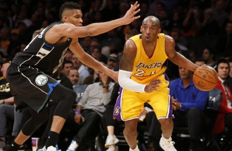 Los Angeles Lakers' Kobe Bryant, right, controls the ball while Milwaukee Bucks' Giannis Antetokounmpo defends during the second half of an NBA basketball game Tuesday, Dec. 15, 2015, in Los Angeles. The Lakers won 113-95. (AP Photo/Danny Moloshok)