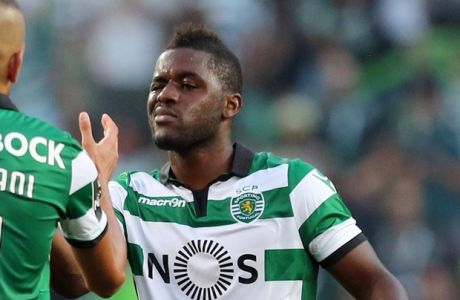 Sporting's Joel Campbell, right, celebrates with teammate Islam Slimani at the end of the Portuguese league soccer match between Sporting CP and FC Porto at the Alvalade stadium in Lisbon, Sunday, Aug. 28 2016. Sporting won 2-1. (AP Photo/Armando Franca)