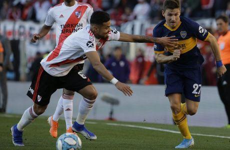 Φράνκο Σολδάνο και Πάουλο Ντίας διεκδικούν την μπάλα στη διάρκεια του ντέρμπι Μπόκα Τζούνιορς - Ρίβερ Πλέιτ (0-0) στο Μπουένος Άιρες, την 1η Σεπτεμβρίου του 2019. (AP Photo/Daniel Jayo)