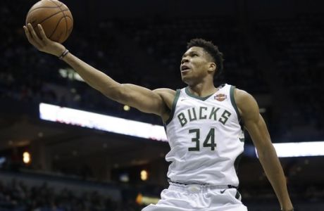Milwaukee Bucks' Giannis Antetokounmpo shoots during the second half of an NBA basketball game against the Miami Heat Wednesday, Jan. 17, 2018, in Milwaukee. The Heat won 106-101. (AP Photo/Morry Gash)