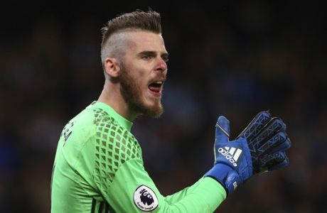 Manchester United's goalkeeper David de Gea reacts during the English Premier League soccer match between Manchester City and Manchester United at the Etihad Stadium in Manchester, England,Thursday, April 27, 2017.(AP Photo/Dave Thompson)