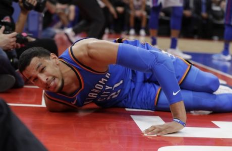 Oklahoma City Thunder guard Andre Roberson lies on the court after slipping during the second half of the team's NBA basketball game against the Detroit Pistons, Saturday, Jan. 27, 2018, in Detroit. (AP Photo/Carlos Osorio)