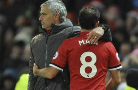 Manchester United's manager Jose Mourinho hugs his player Manchester United's Juan Mata as he is substituted during the English Premier League soccer match between Manchester United and Stoke City at Old Trafford in Manchester, England, Monday, Jan. 15, 2018. (AP Photo/Rui Vieira)