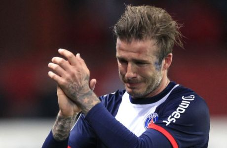 Paris Saint Germain's midfielder David Beckham from England cries as he leaves the field, during his French League One soccer match against Brest, at the Parc des Princes stadium, in Paris, Saturday, May 18, 2013. (AP Photo/Thibault Camus)
