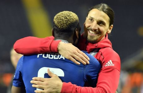 United's Zlatan Ibrahimovic, right, celebrates with teammate Paul Pogba after winning the soccer Europa League final between Ajax Amsterdam and Manchester United at the Friends Arena in Stockholm, Sweden, Wednesday, May 24, 2017. United won 2-0. (AP Photo/Martin Meissner)