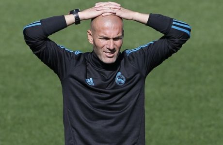 Real Madrid's head coach Zinedine Zidane watches his players during a training session in Madrid, Spain, Tuesday, Sept. 12, 2017. Real Madrid will play APOEL Nikosia Wednesday in a Group H Champions League soccer match. (AP Photo/Paul White)